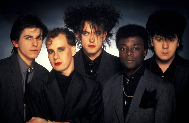 The Cure in 1984, with Andy Anderson second from right.