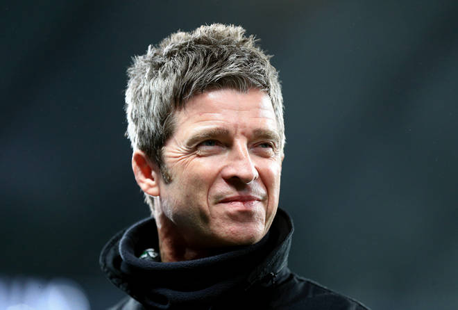 Noel Gallagher is interviewed before the match during the Premier League match between Manchester City and Manchester United at Etihad Stadium
