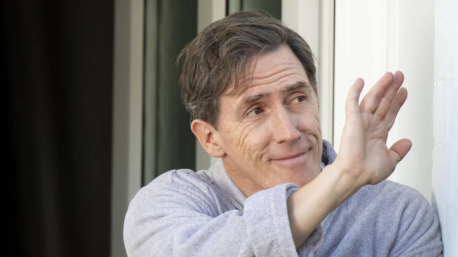 Rob Brydon, who plays Bryn West, is seen waving during filming for the Gavin and Stacey Christmas special on Trinity Street on July 12, 2019 in Barry, Wales.