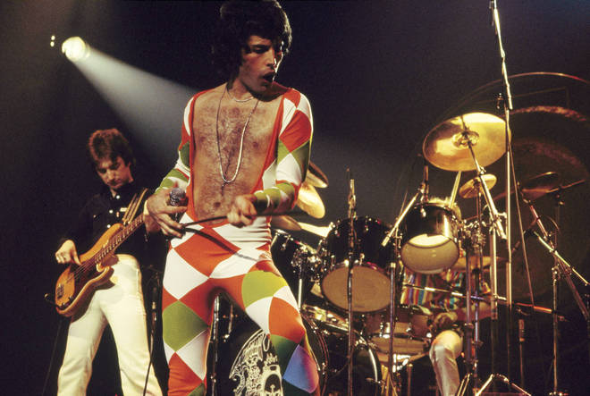 Queen perform onstage at Madison Square Garden, December 1977
