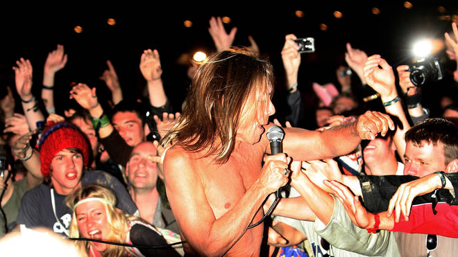 Iggy Pop jumps into the crowd off the Other Stage at Glastonbury 2007
