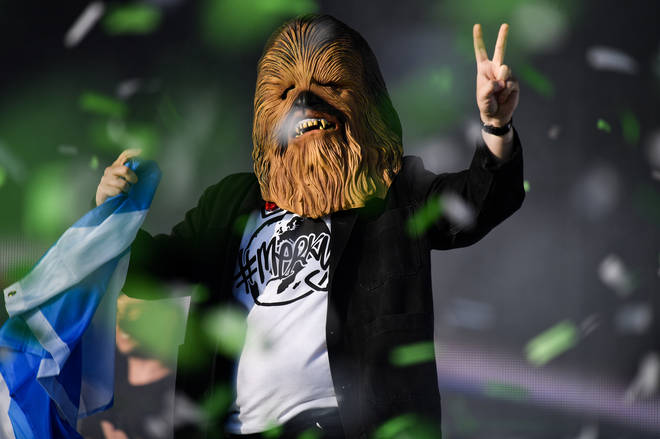 Lewis Capaldi comes on stage wearing a Chewbacca mask to perform on the main stage during the TRNSMT Festival at Glasgow Green on July 14, 2019