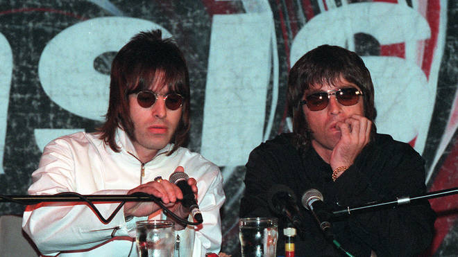 Oasis band members Liam and Noel Gallagher at a press conference in 1999