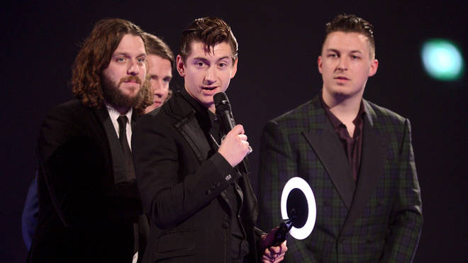 Alex Turner, Nick O'Malley, Jaime Cook and Matt Helders of Arctic Monkeys receive the award for the MasterCard British Album of the Year at The BRIT Awards 2014