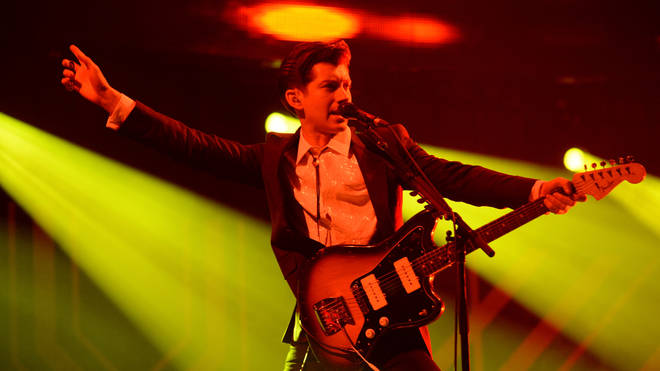 Alex Turner of Arctic Monkeys performs onstage at the 24th Annual KROQ Almost Acoustic Christmas at The Shrine Auditorium on December 7, 2013