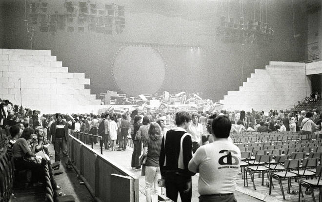Crowds survey the aftermath of Pink Floyd's Wall show in August 1980.