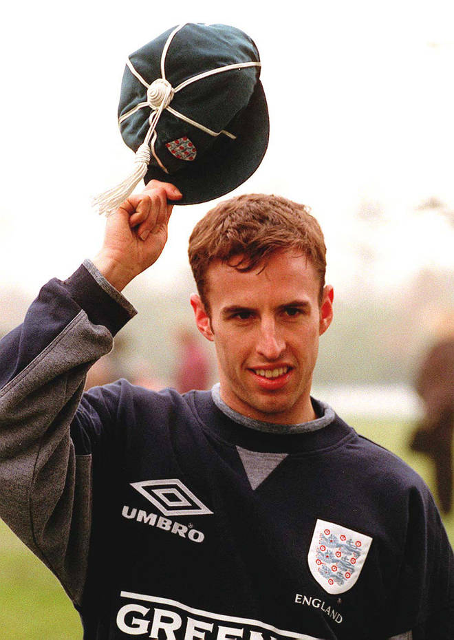 Aston Villa's Gareth Southgate holds up his first cap for England in 1996