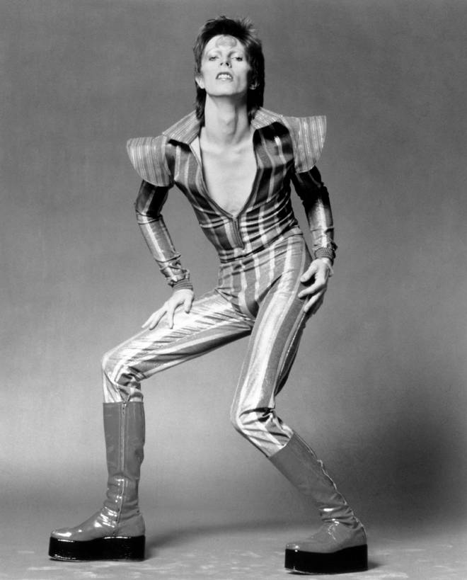 David Bowie wearing the classic glam rock stacked boots in June 1972