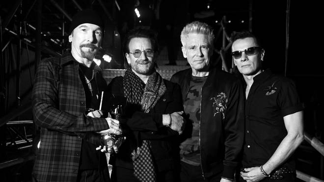 The Edge, Bono, Adam Clayton and Larry Mullen Jr of U2 pose with the Global Icon award during the MTV EMAs 2017 held at The SSE Arena, Wembley on November 12, 2017