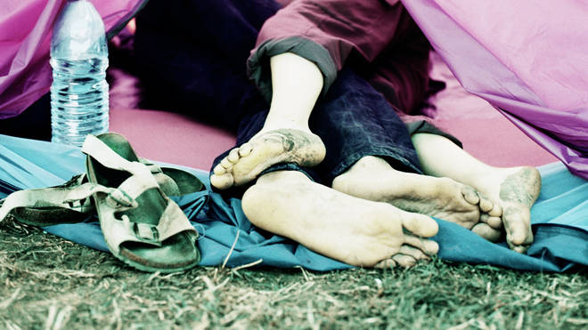 Couple kissing in tent at Glastonbury Festival