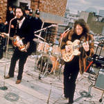 Paul McCartney and John Lennon performing on the roof of the Apple building, 30 January 1969