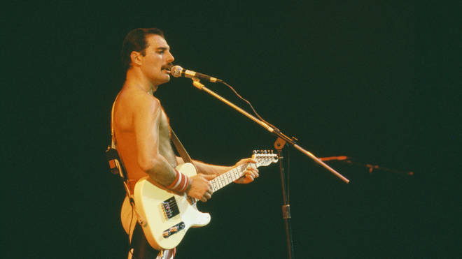 Freddie Mercury playing guitar during Queen's performance at the Rock in Rio festival, Brazil, January 1985.