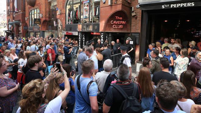 Fans gather to see Paul McCartney at The Cavern Club in 2018