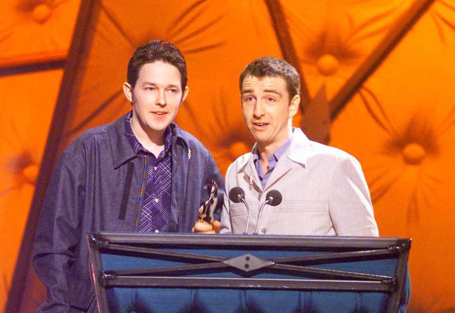 Mick Cooke and Richard Colburn of the band Belle & Sebastian, winners of Best Britist Newcomer Award, during the Brit Award 1999.