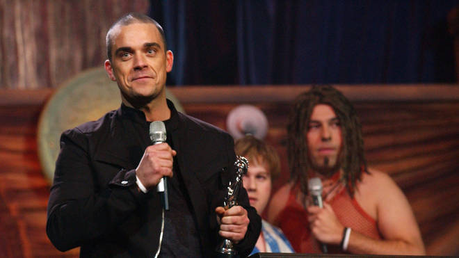 Robbie Williams receives the Best Song award for Angels in 2005