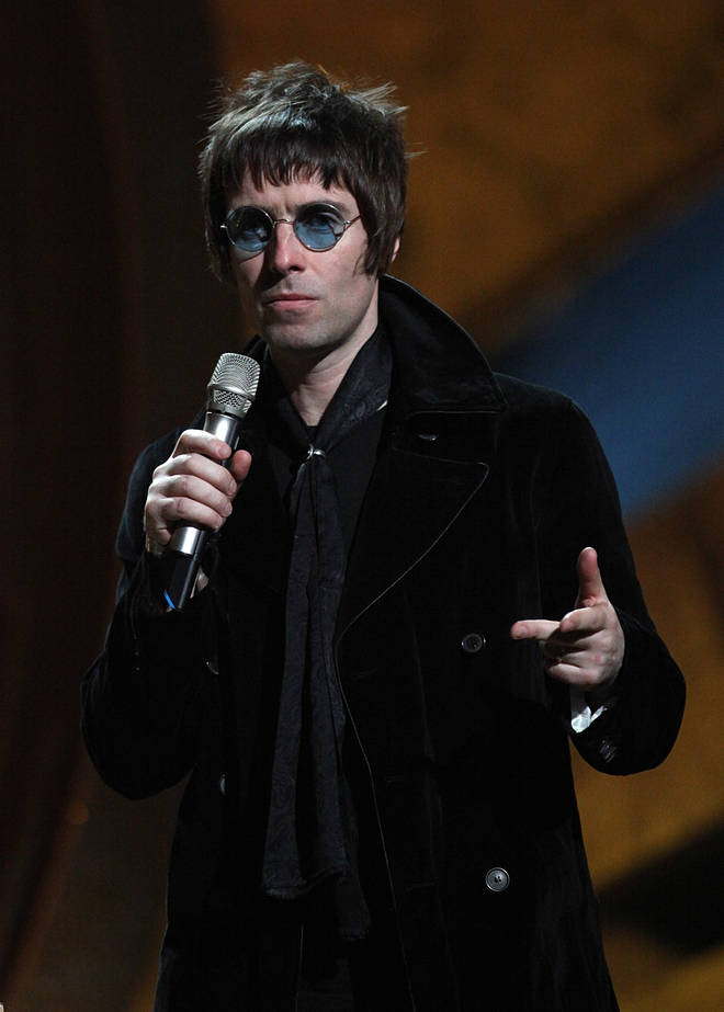 Liam Gallagher on stage to collect the award for BRITs Album Of 30 Years won by Oasis during the BRIT Awards 2010