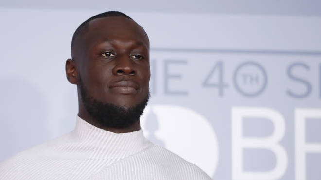 Stormzy poses on the red carpet on arrival for the BRIT Awards 2020 in London