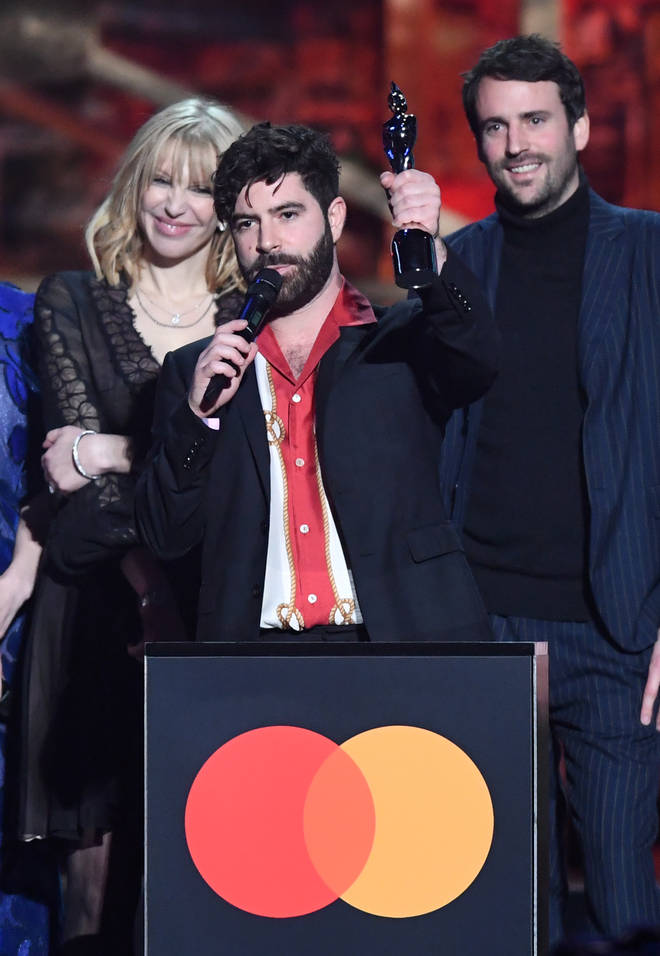 Yannis Philippakis of the band Foals accepts the Best Group award during The BRIT Awards 2020 a