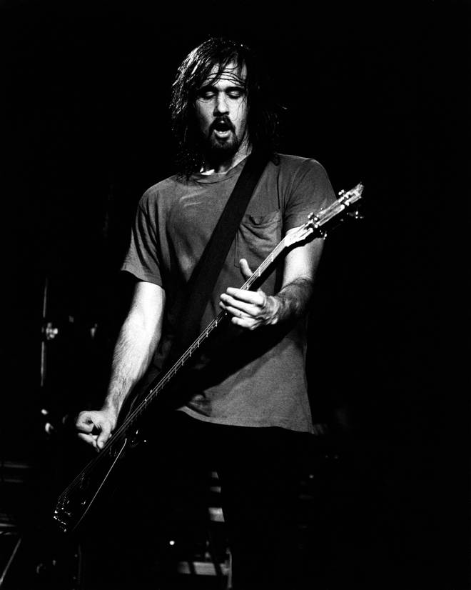 Krist Novoselic performing live onstage with Nirvana in November 1991