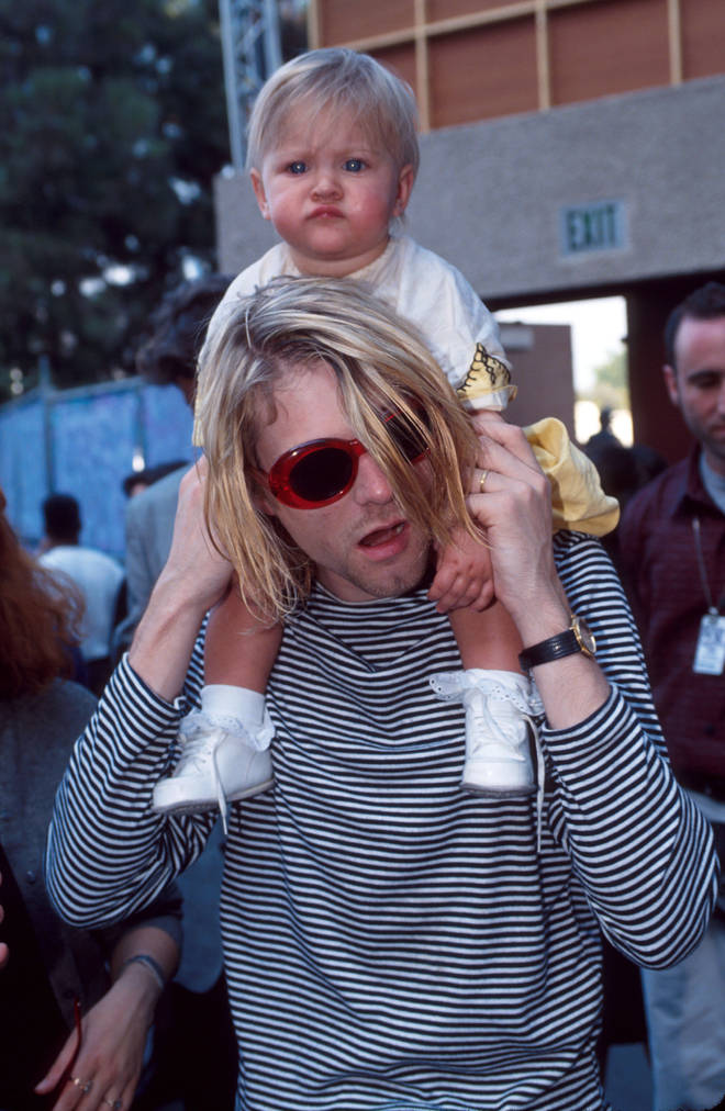 Kurt Cobain of Nirvana and daughter Frances Bean Cobain at the MTV Video Music Awards, 1993