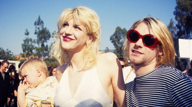 Courtney Love, Kurt Cobain and their daughter Frances Bean at the 1993 MTV awards