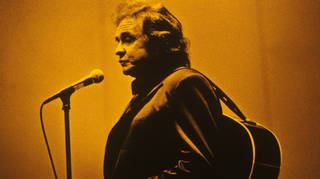 Johnny Cash performing on stage, 1994