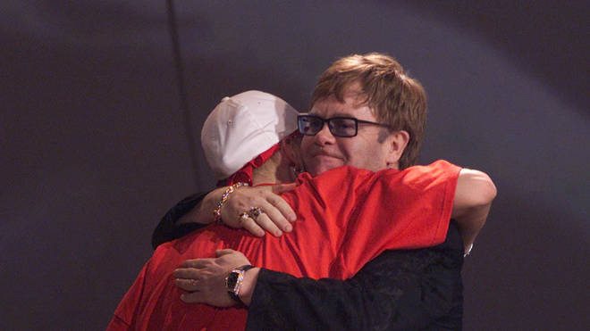 Eminem hugging Elton John at the 2001 BRIT Awards