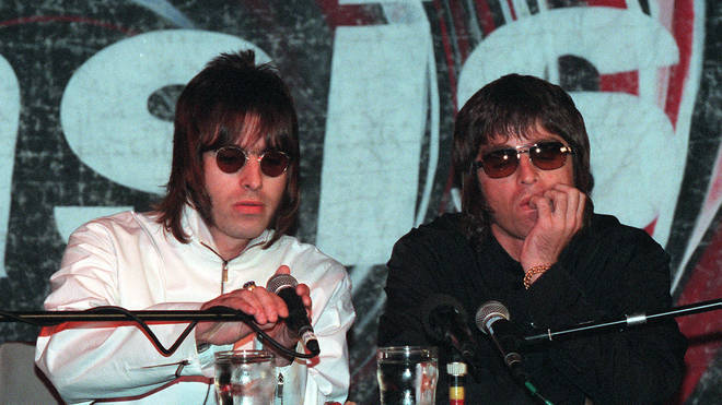 Oasis band members Liam and Noel Gallagher at a press conference to announce the departure of the band's two founding member Guigsy and Bonehead. august 1999