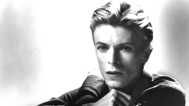 David Bowie poses for a portrait in 1977