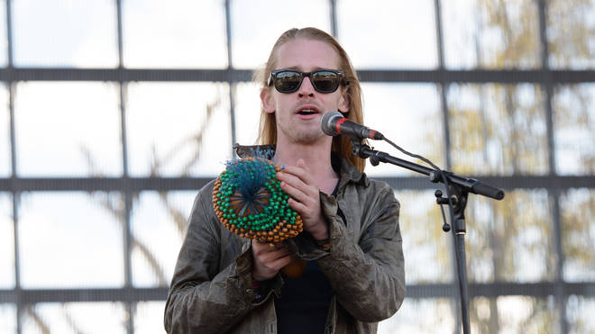 Macaulay Culkin of The Pizza Underground performs on stage at Riot Fest Chicago 2014