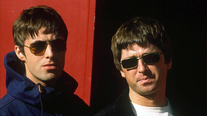Liam and Noel Gallagher on tour with Oasis in 1997