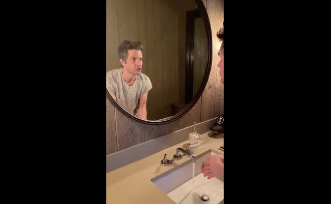 The Killers' Brandon Flowers sings Mr. Brightside as he washes his hands