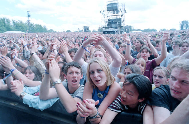 The crowd at Knebworth watch Oasis