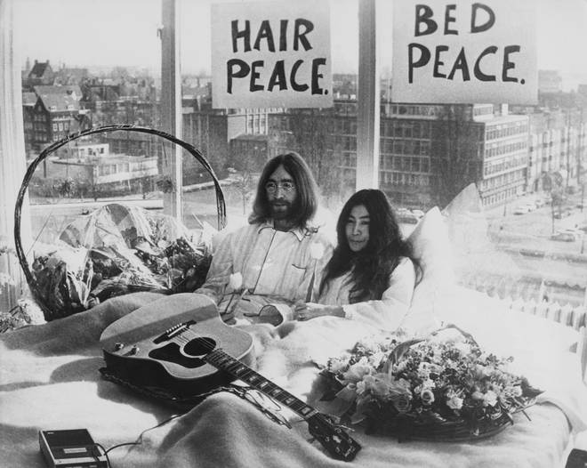 John Lennon and Yoko Ono in their bed in the Presidential Suite of the Hilton Hotel, Amsterdam, 25th March 1969