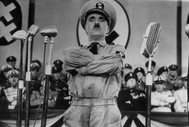 Charlie Chaplin directs and stars in the film 'The Great Dictator'.