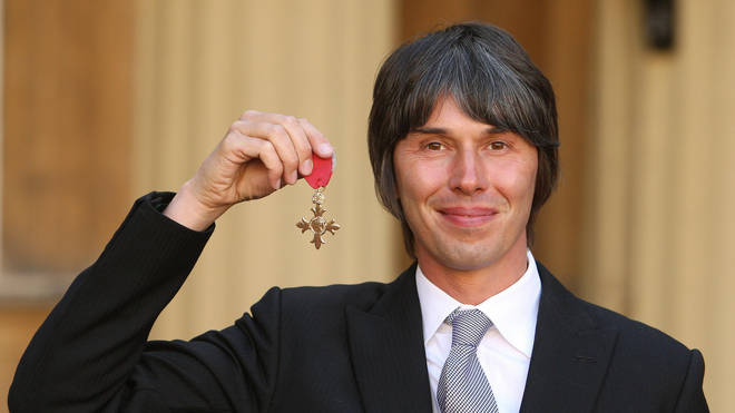 Professor Brian Cox with his OBE