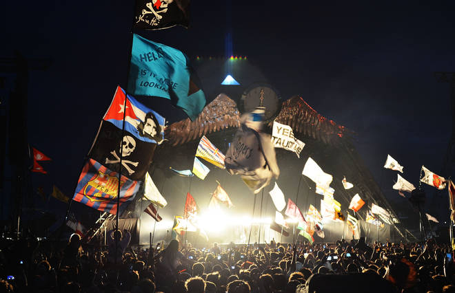 A general view of the flags and crowd in front of the  Pyramid stage as Kanye West performs live during the second day of Glastonbury Festival at Worthy Farm, Pilton on June 27, 2015