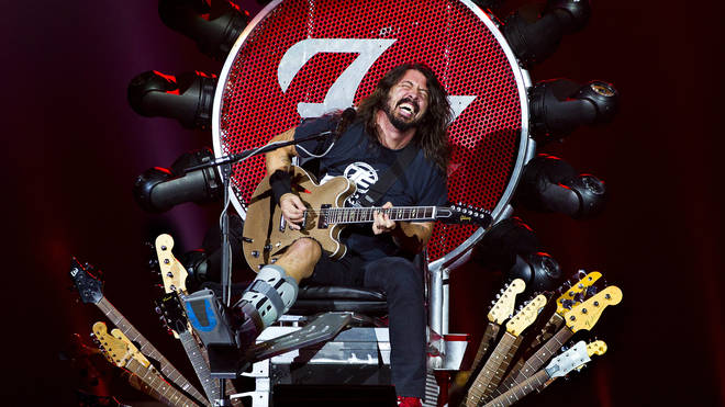 Dave Grohl takes the weight off his broken leg onstage in Amsterdam, 2015