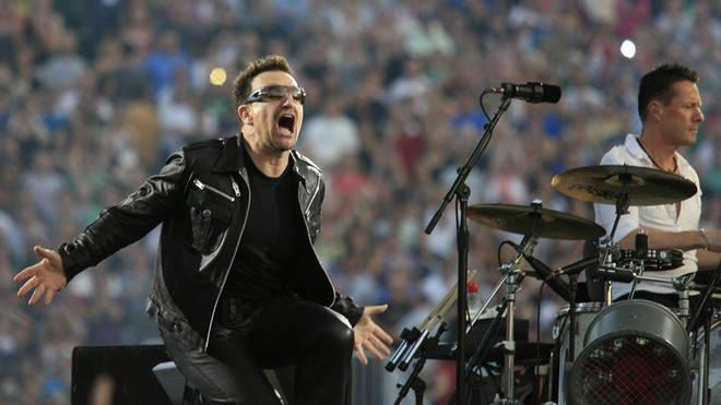 Bono performing with U2 on their 360° Tour, 2011