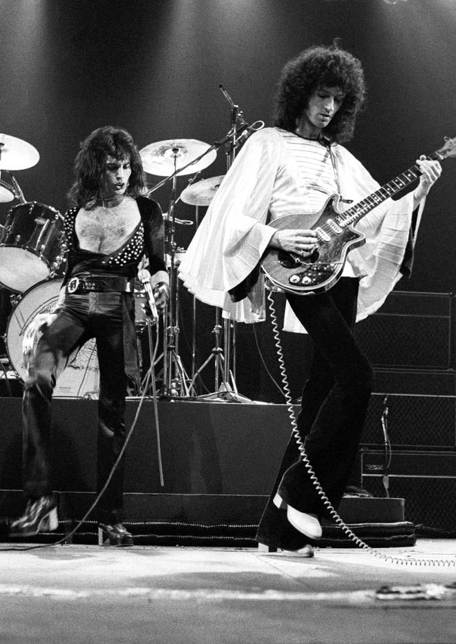 Freddie Mercury and Brian May performing live on stage in 1975