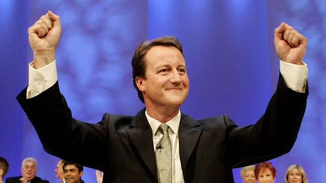 Conservative leadership contender David Cameron salutes the audience following his speech to the Conservative Party conference in Blackpool, 2005