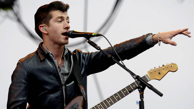 Alex Turner of Arctic Monkeys performs at the 2012 Coachella Festival