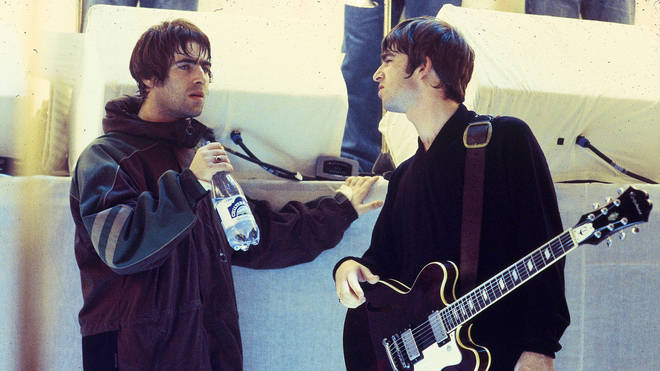 Liam Gallagher and Noel Gallagher, talking on the set of The White Room in 1996