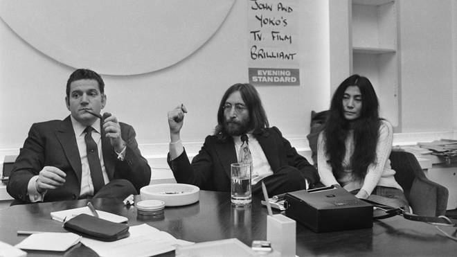 Allen Klein with John and Yoko, negotiates over the purchase of The Beatles' song publishing. This does not end well.