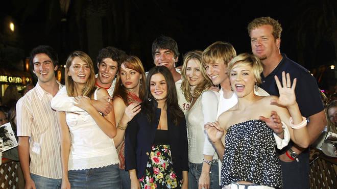 The O.C cast and crew in 2003: creator Josh Schwartz, cast members Mischa Barton, Adam Brody, Melinda Clarke, Peter Gallagher, Rachel Bilson, Kelly Rowan, Benjamin McKenzie, Samaire Armstrong and producer McG