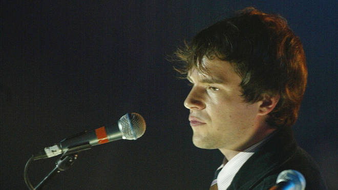 Brandon Flowers performing with The Killers onstage in September 2004