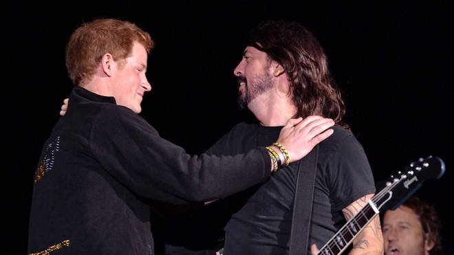 Prince Harry and Dave Grohl from the Foo Fighters attend the Invictus Games closing ceremony at Queen Elizabeth Olympic Park on September 14, 2014