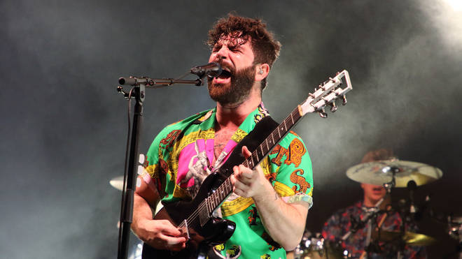 Yannis on stage with Foals in July 2019