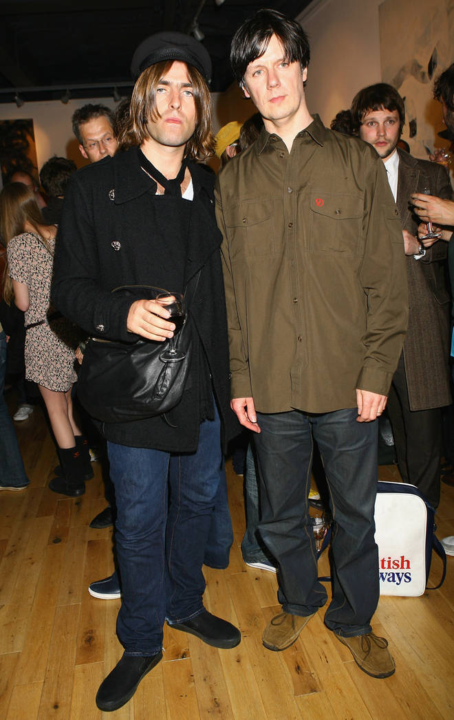 Liam Gallagher joins Stone Roses man John Squire at his gallery launch; in the background, a stunned Gordon Smart seeks solace in his nice coat