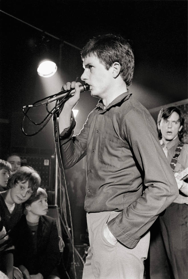Ian Curtis thinking about what time he needs to be back at his desk tomorrow morning during Joy Division's set at Bowdon Vale Youth Club on 14 March 1979.